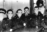 Men in uniform at mess table: Larsen, Russill, Dicken, Diplock, Hunt, Peters. From the Russill collection.