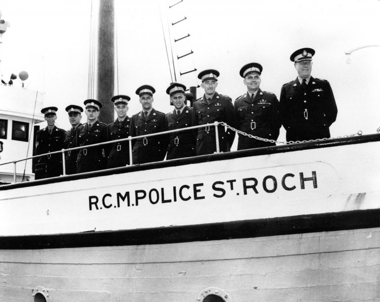 HCSR-50-04. 1954 Crewmembers on foredeck of St. Roch. Left to Right: Braun, Mott, Brunner, Shaw, Dauphniee, Jennings, Teilman, Mossman, Larsen.